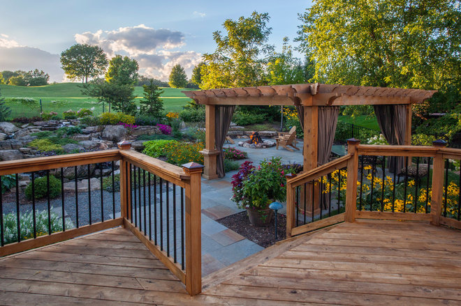 Traditional Deck by Rolling Landscapes Inc.
