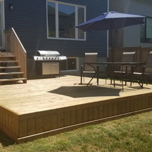 Example of a large classic backyard deck skirting design in Ottawa