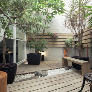 Design ideas for a small asian courtyard deck in Other with no cover.