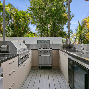 Small tropical rooftop deck in Cairns with an outdoor kitchen and no cover.