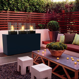 Deck - large contemporary backyard deck idea in Toronto with a fire pit