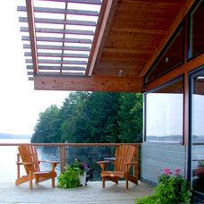 Rustic Deck by Altius Architecture, Inc.