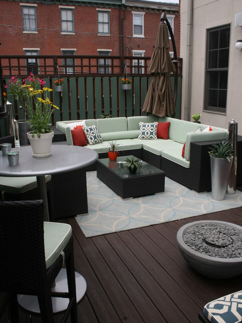 high end patio furniture. transitional deck photo in philadelphia with a fire pit high end patio furniture e