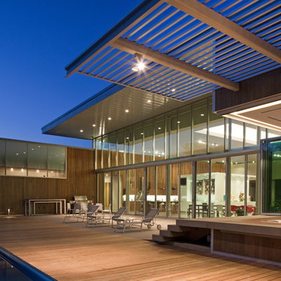 Huge trendy deck photo in Omaha with a pergola