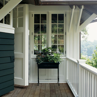 Example of an arts and crafts deck design in Baltimore
