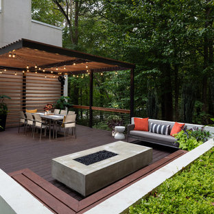 Large contemporary backyard deck in Atlanta with a fire feature and a pergola.