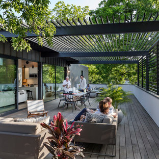 Design ideas for a modern rooftop deck in Austin with a pergola.