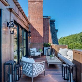Immagine di una terrazza chic sul tetto e sul tetto con parapetto in metallo e nessuna copertura