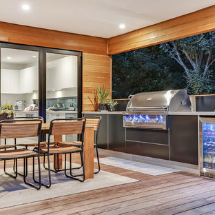Inspiration for a beach style deck in Melbourne with an outdoor kitchen and a roof extension.