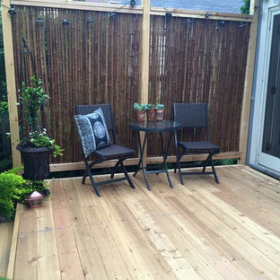 Design ideas for a mid-sized asian backyard deck in Minneapolis with no cover.