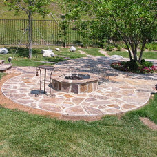 Traditional Deck by Capital Construction & Development, Inc.