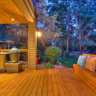 This is an example of an expansive arts and crafts backyard deck in Portland.