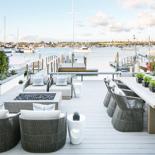 Design ideas for a beach style backyard deck in Orange County with with dock and no cover.