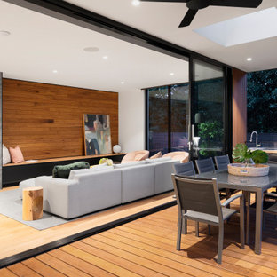 Large trendy courtyard outdoor kitchen deck photo in Melbourne with a roof extension