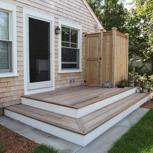Inspiration for a small beach style backyard deck in Providence with an outdoor shower.