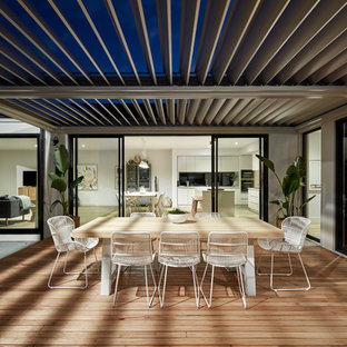 Photo of a contemporary backyard deck in Melbourne with a pergola.