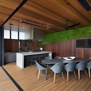Design ideas for a contemporary deck in Melbourne with an outdoor kitchen and a roof extension.