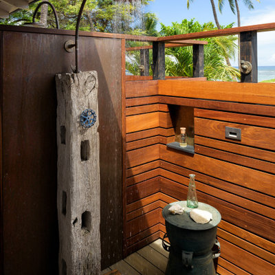 Example of a small beach style backyard outdoor shower deck design in Hawaii with a roof extension