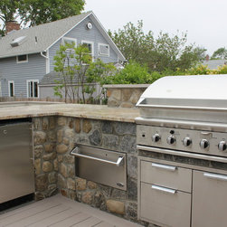 BEACH SIDE LIVING - Madison, CT. Outdoor kitchen designer Michael Gotowala of Preferred Properties Landscaping and Masonry adds outdoor kitchen attributes to this beach house to make living beyond the walls of this beach side home truly spectacular. Narrowed by lot size and property constraints, it was Michaels vision that motivated owners to incorporate an outdoor kitchen, sunken hot tub and remote controlled outdoor fire tower into an expanded deck over and above the owners thought out outdoor living design that got the ball rolling.