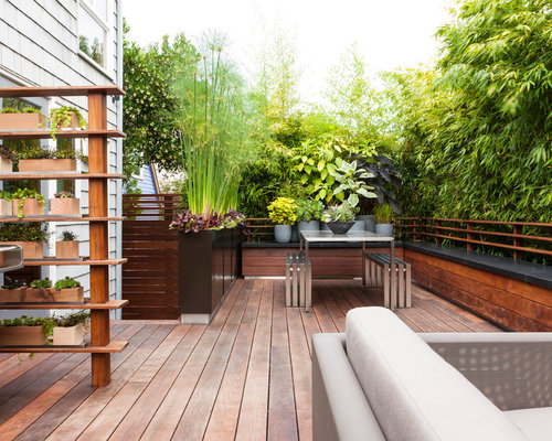 Inspiration for a contemporary backyard deck remodel in Seattle with a ...