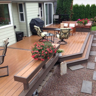 Inspiration for a mid-sized contemporary backyard deck remodel in Seattle with no cover