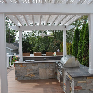 Inspiration for a small timeless backyard outdoor kitchen deck remodel in New York with a pergola