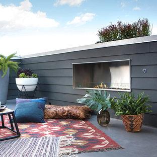 Esempio di una terrazza design sul tetto e sul tetto con nessuna copertura