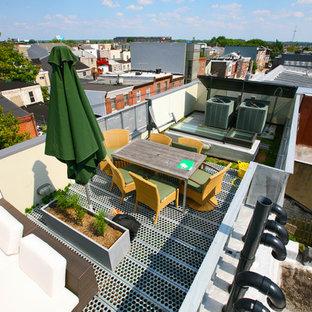 Ispirazione per una terrazza industriale di medie dimensioni e sul tetto con nessuna copertura