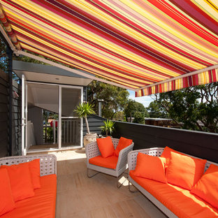 Inspiration for a mid-sized contemporary rooftop deck remodel in Sydney with an awning