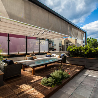 Design ideas for a medium sized contemporary roof terrace and balcony in Chicago with an outdoor kitchen and an awning.