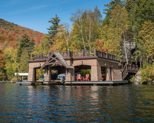 large mountain style backyard dock photo in new york with a roof extension - Boat Dock Design Ideas
