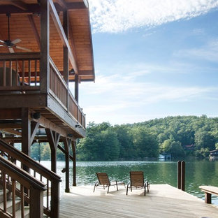 Dock - mid-sized traditional side yard dock idea in Other with a roof extension
