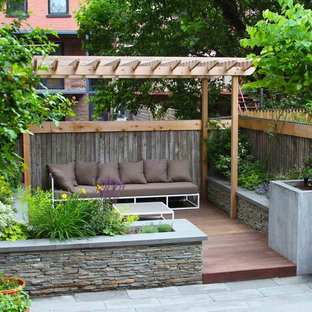 Traditional deck in New York with a pergola.