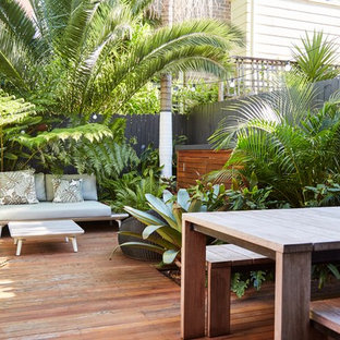 This is an example of a tropical backyard deck in Sydney with no cover.