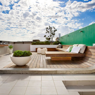 Mid-sized contemporary rooftop deck in Sydney with no cover.