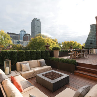 This is an example of an expansive classic roof terrace and balcony in Boston with an outdoor kitchen and no cover.