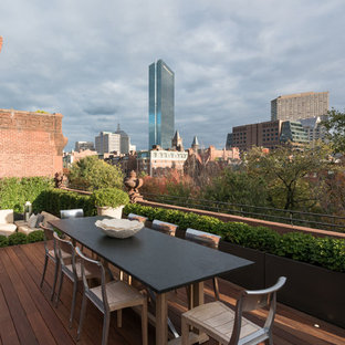 Huge transitional rooftop outdoor kitchen deck photo in Boston with no cover