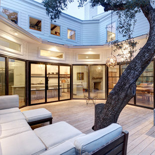 Inspiration for a large transitional backyard deck remodel in Austin