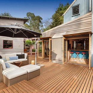 This is an example of a beach style deck in Melbourne.