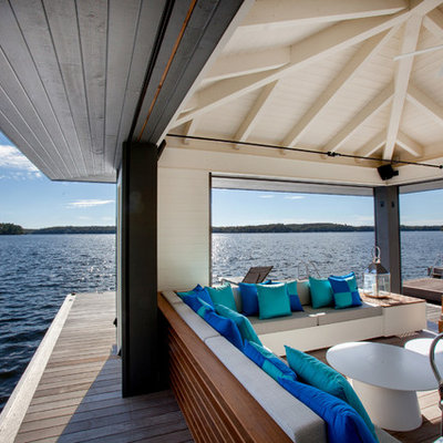 Inspiration for a mid-sized coastal backyard dock remodel in Toronto with a roof extension