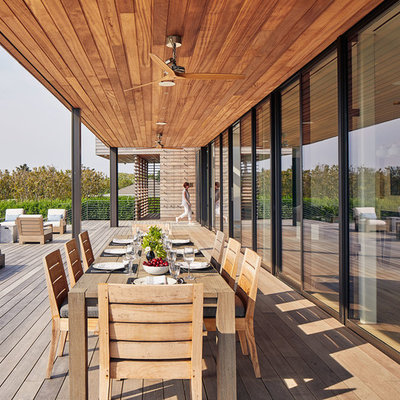 Deck - huge coastal deck idea in New York with a roof extension