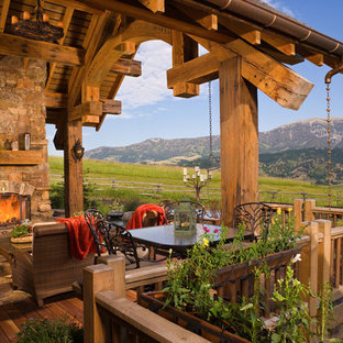 Deck - rustic deck idea in Other with a fire pit