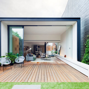 Design ideas for a contemporary backyard deck in Melbourne with no cover.