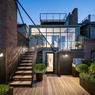 Ispirazione per una grande terrazza moderna dietro casa con nessuna copertura