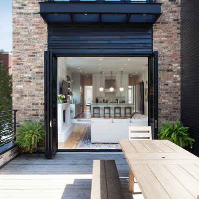 Mid-sized minimalist rooftop deck photo in Chicago with a roof extension