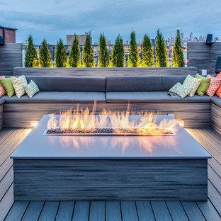 Foto di ampi terrazze e balconi minimalisti sul tetto con un focolare e nessuna copertura