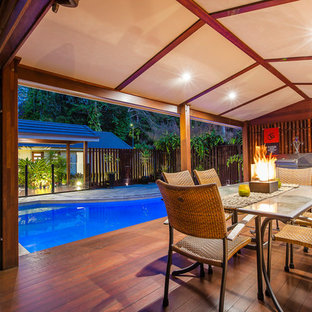 Outdoor kitchen deck - asian backyard outdoor kitchen deck idea in Sunshine Coast with a roof extension