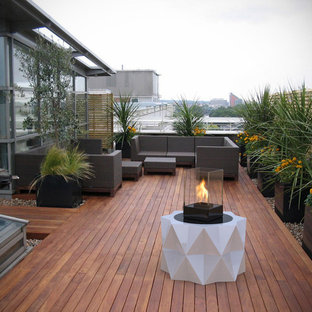Deck - large contemporary rooftop deck idea in Toronto with a fire pit