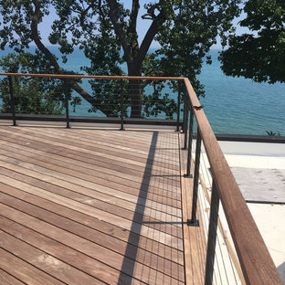 Example of a large transitional backyard deck design in Chicago