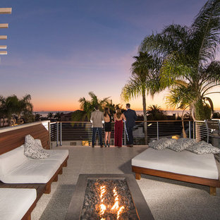 Example of a mid-sized minimalist rooftop deck design in San Diego with a fire pit and a pergola